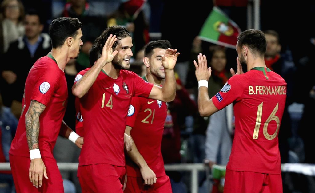 FARO, Nov. 15, 2019 - Goncalo Paciencia (2nd L) of Portugal celebrates during the group B match against Lithuania at the UEFA Euro 2020 qualifier at the Algarve stadium in Faro, Portugal, Nov. 14, ...