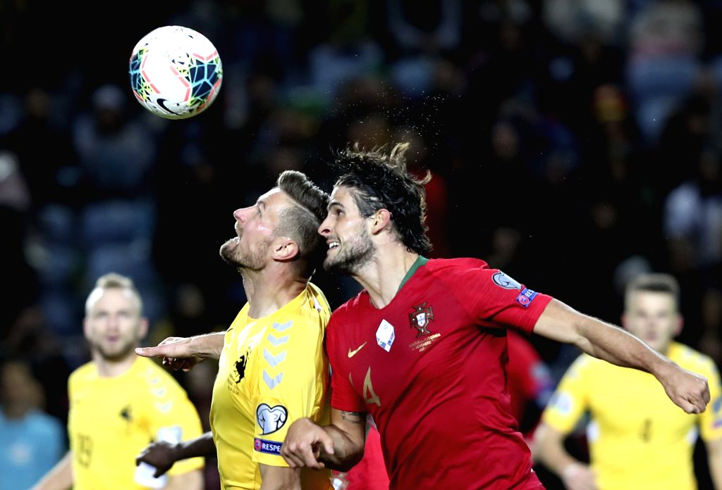 FARO, Nov. 15, 2019 - Goncalo Paciencia (R) of Portugal vies with Markus Palionis of Lithuania during the group B match at the Euro 2020 qualifier at the Algarve stadium in Faro, Portugal, Nov. 14, ...