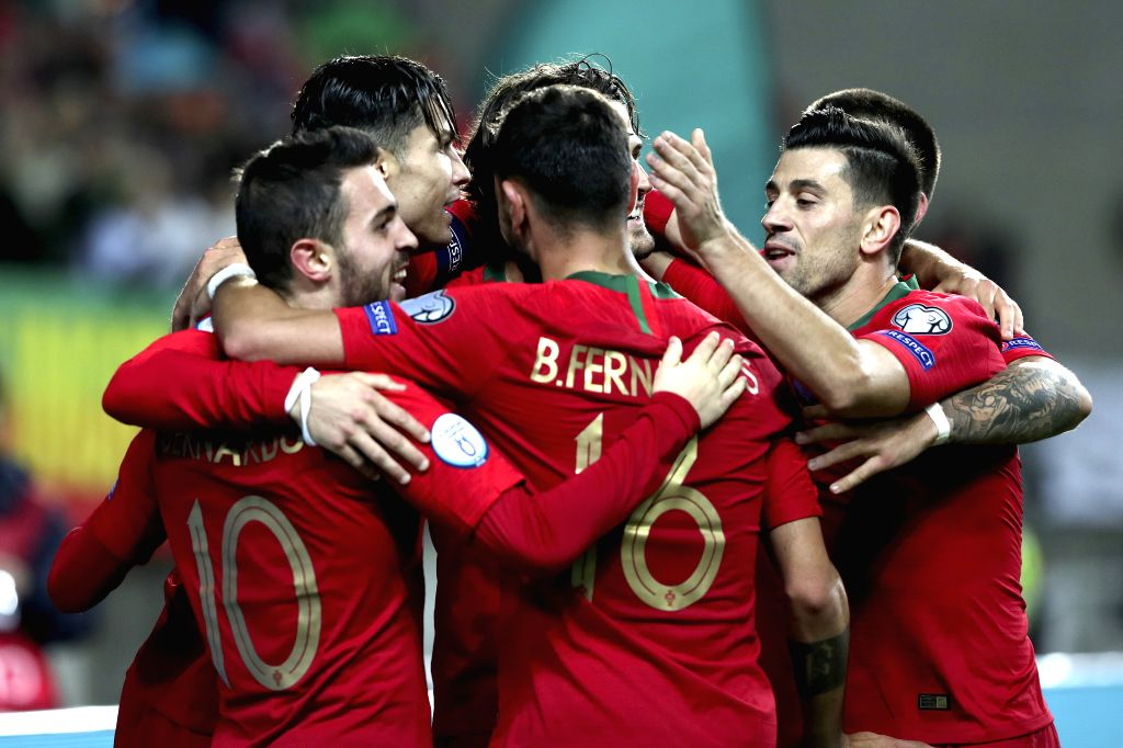 FARO, Nov. 15, 2019 - Players of Portugal celebrate during the group B match against Lithuania at the UEFA Euro 2020 qualifier at the Algarve stadium in Faro, Portugal, Nov. 14, 2019.