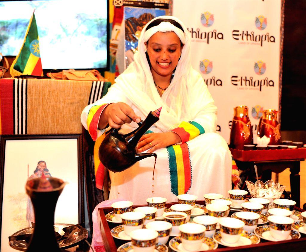 FARWANIYA GOVERNORATE (KUWAIT), Dec. 8, 2019 An exhibitor serves Ethiopian coffee at an exhibition during the Africa Day celebration in Farwaniya Governorate, Kuwait, on Dec. 8, 2019. ...
