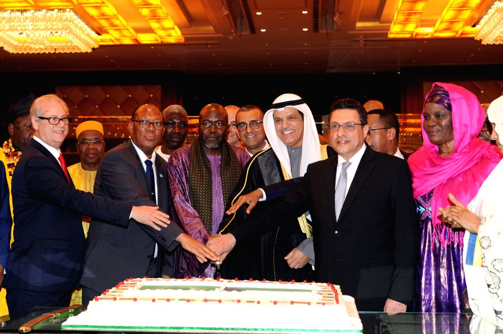 FARWANIYA GOVERNORATE (KUWAIT), Dec. 8, 2019 Officials and diplomats cut a cake during the Africa Day celebration in Farwaniya Governorate, Kuwait, on Dec. 8, 2019. Embassies of more than ...