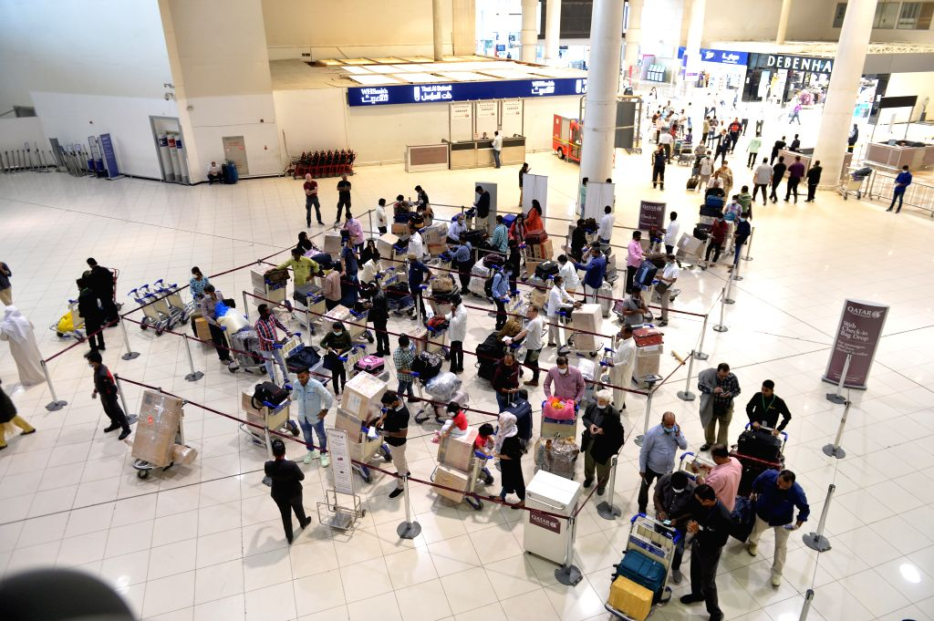 FARWANIYA GOVERNORATE, March 12, 2020 (Xinhua) -- Photo taken on March 12, 2020 shows the arrival hall of Kuwait International Airport in Farwaniya Governorate, Kuwait. Kuwait has decided on Wednesday to suspend the commercial flights to and from the