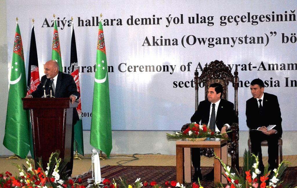FARYAB, Nov. 29, 2016 - Afghan President Ashraf Ghani (L) and Turkmen President Gurbanguly Berdymukhamedov (C) attend an inauguration ceremony of a railway linking the two countries in Faryab ...