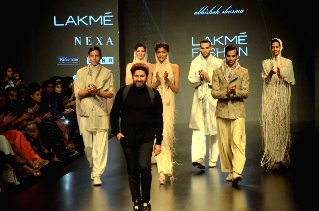 Fashion designer Abhishek Sharma with models showcasing his creations during the Lakme Fashion Week (LFW) Summer/Resort 2019 in Mumbai on Feb 2, 2019. - Abhishek Sharma