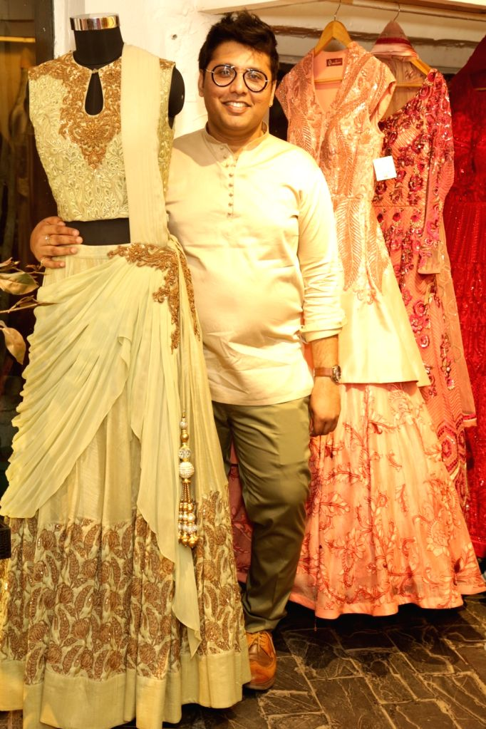 Fashion designer Aditya Khandelwl with his creations during Amazon India Fashion Week in New Delhi on April 6, 2018.