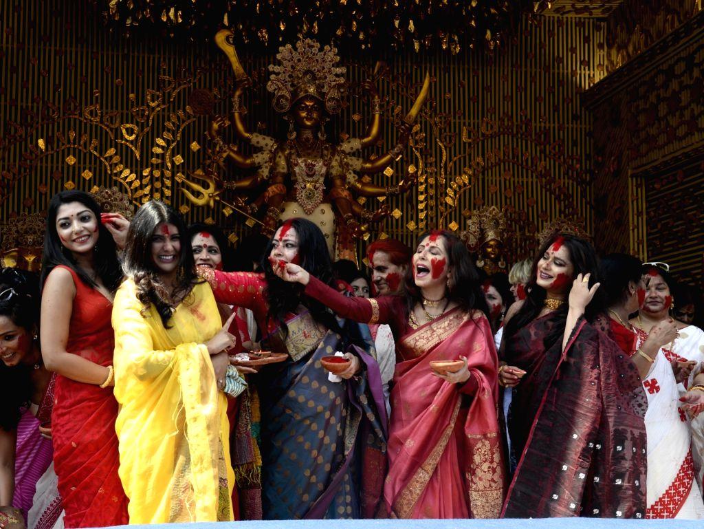 Fashion designer and BJP leader Agnimitra Paul, actors Chaiti Ghoshal, Parno Mitra and Ananya Chatterjee celebrate 'Sindur Khela' at Chaltabagan in Kolkata on Oct 11, 2019. - Chaiti Ghoshal, Parno Mitra and Ananya Chatterjee
