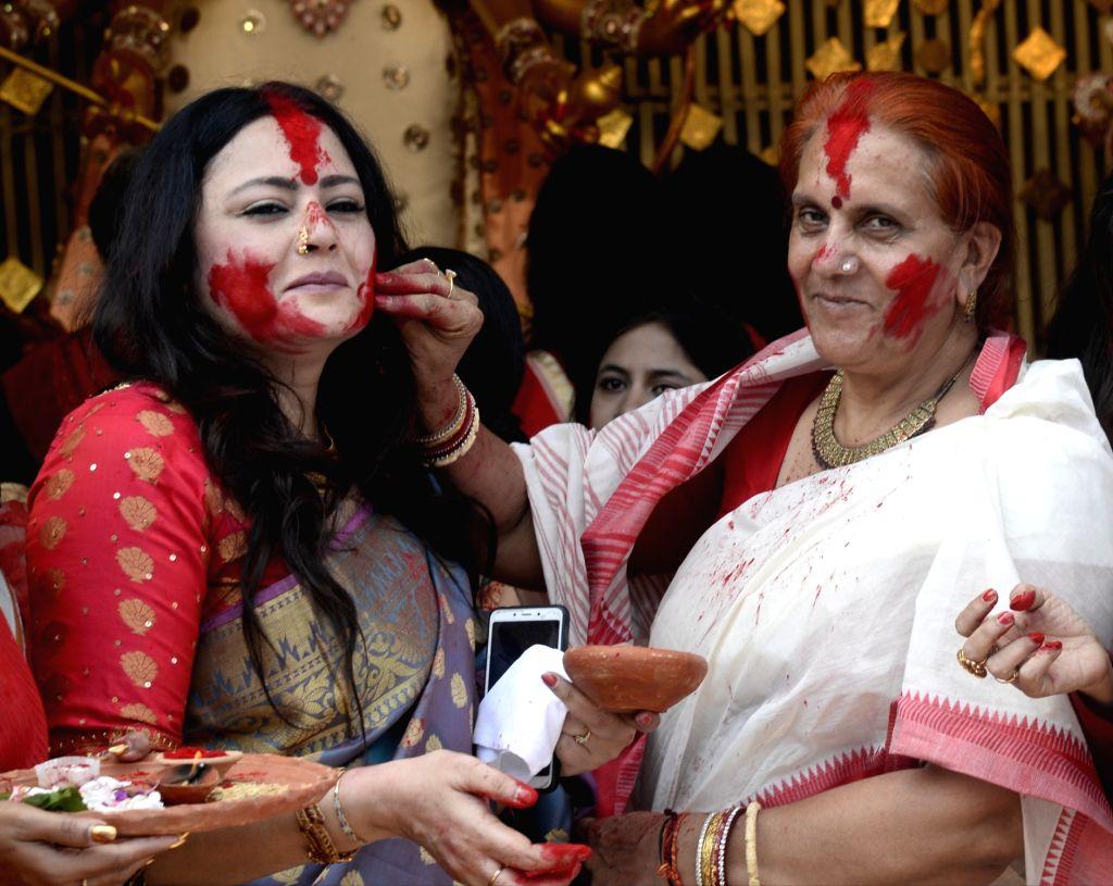 Fashion designer and BJP leader Agnimitra Paul celebrates 'Sindur Khela' at Chaltabagan in Kolkata on Oct 11, 2019.