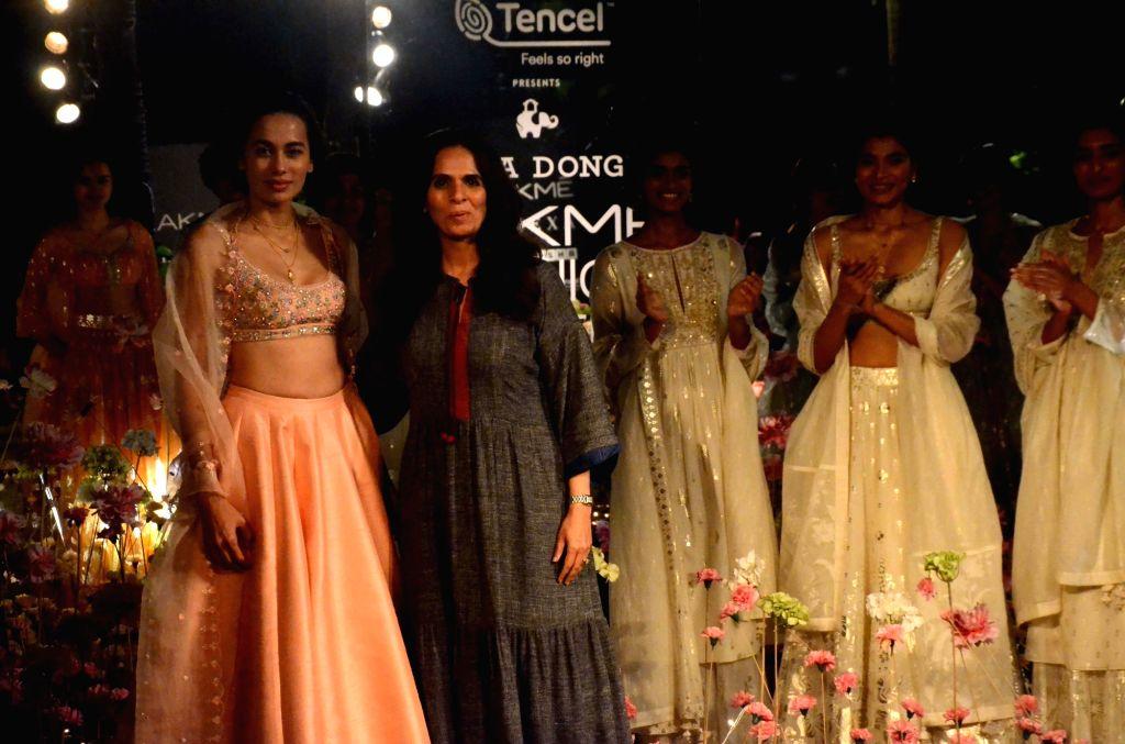 Fashion designer Anita Dogre with models showcasing her creation on Day 2 of the Lakme Fashion Week (LFW) Summer/Resort 2019 in Mumbai, on Jan 31, 2019.