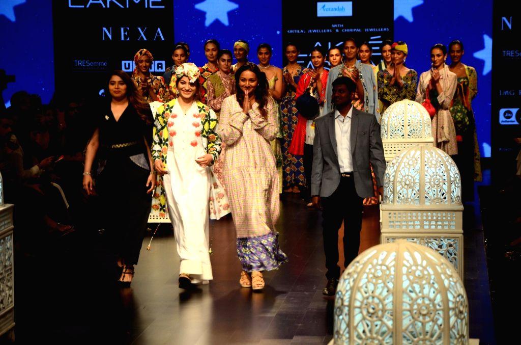 Fashion designer Anjali Patel Mehta with actress Urvashi Rautela at Lakme Fashion Week (LFW) Summer/Resort 2019 in Mumbai, on Feb 2, 2019. - Urvashi Rautela and Anjali Patel Mehta