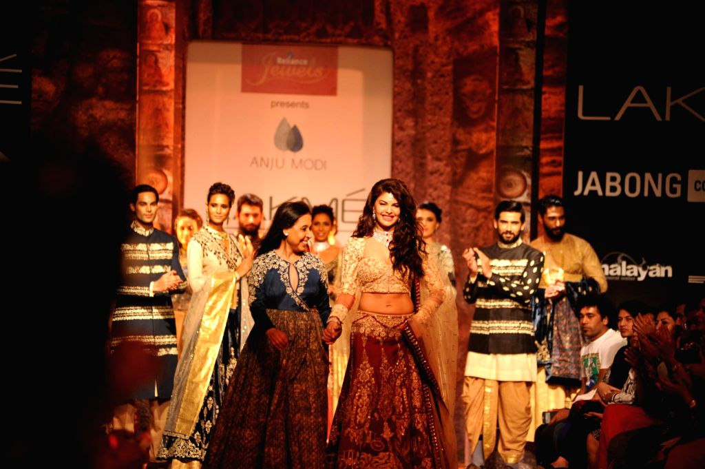 Fashion designer Anju Modi walk with actor Jacqueline Fernandez during his show at the Lakme Fashion Week (LFW) Winter/ Festive 2014 in Mumbai,on Aug 20, 2014. - Jacqueline Fernandez