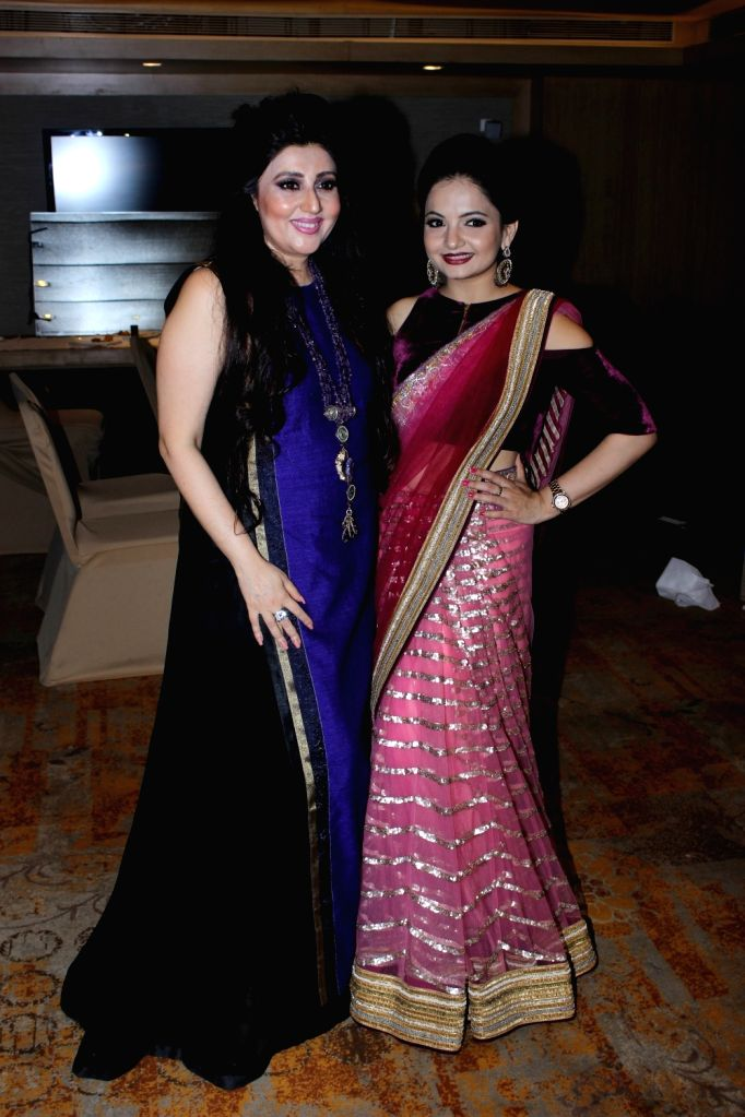 Fashion Designer Archana Kochhar and actress Giaa Manek pose for a photograph during a programme in Mumbai on July 1, 2017. - Giaa Manek