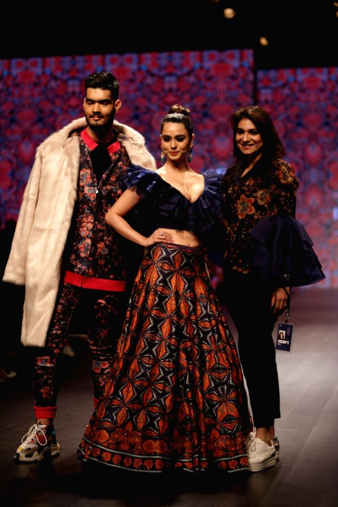 Fashion designer Charu Parashar with the models showcasing her creations on the third day of Lotus India Fashion Week in New Delhi, on March 15, 2019.