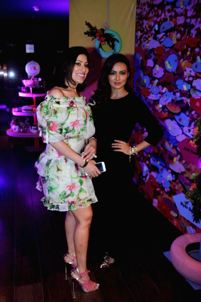 Fashion designer Maheka Mirpuri with actress Sana Khan during the preview of her summer collection, in Mumbai, on April 21, 2016. - Sana Khan