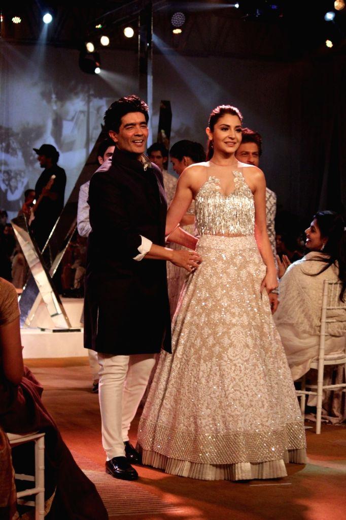 Fashion designer Manish Malhotra and actress Anushka Sharma during the Mijwan Summer 2017 fashion show during the Mijwan Summer 2017 fashion show in Mumbai on March 5, 2017. - Anushka Sharma and Manish Malhotra