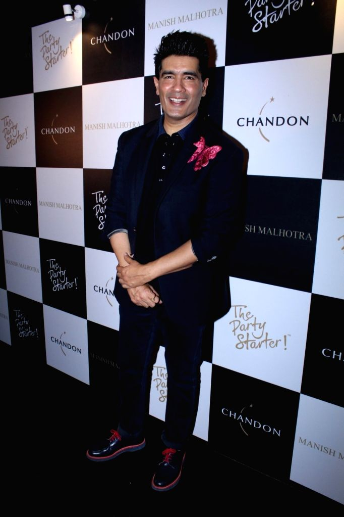 Fashion Designer Manish Malhotra during the launch of his X Chandon Champagne bottles Limited Edition End Of Year 2017 in Mumbai on Oct 9, 2017. - Designer Manish Malhotra
