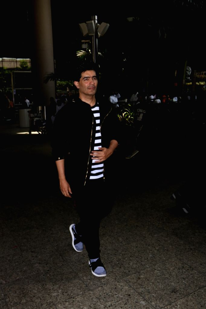 Fashion Designer Manish Malhotra seen at Chhatrapati Shivaji Maharaj International airport in Mumbai. - Designer Manish Malhotra