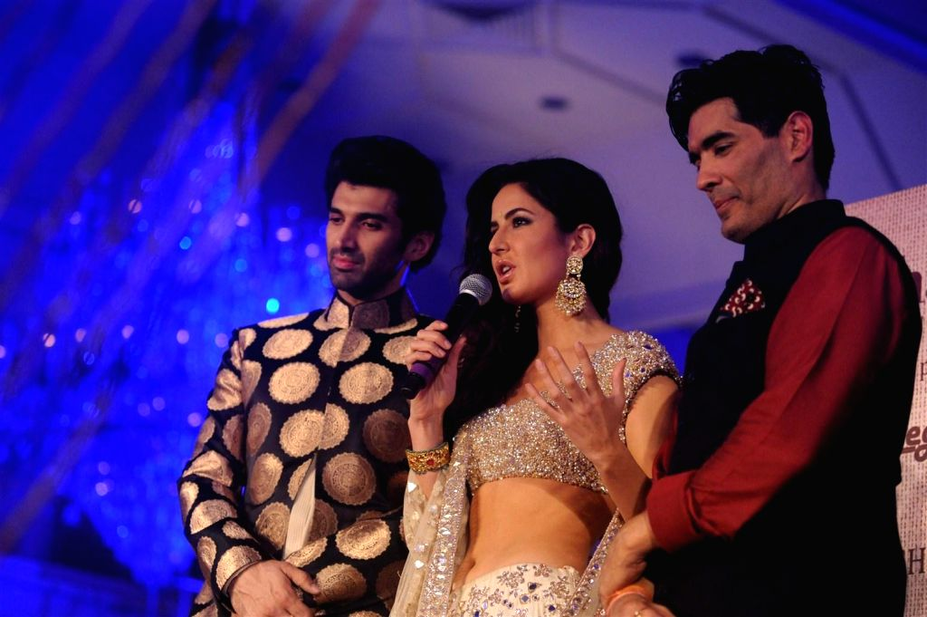 Fashion designer Manish Malhotra with actors Katrina Kaif and Aditya Roy Kapur during the fashion show by designer Manish Malhotra in Mumbai, on January 14, 2016. Manish named the collection ... - Katrina Kaif and Aditya Roy Kapur