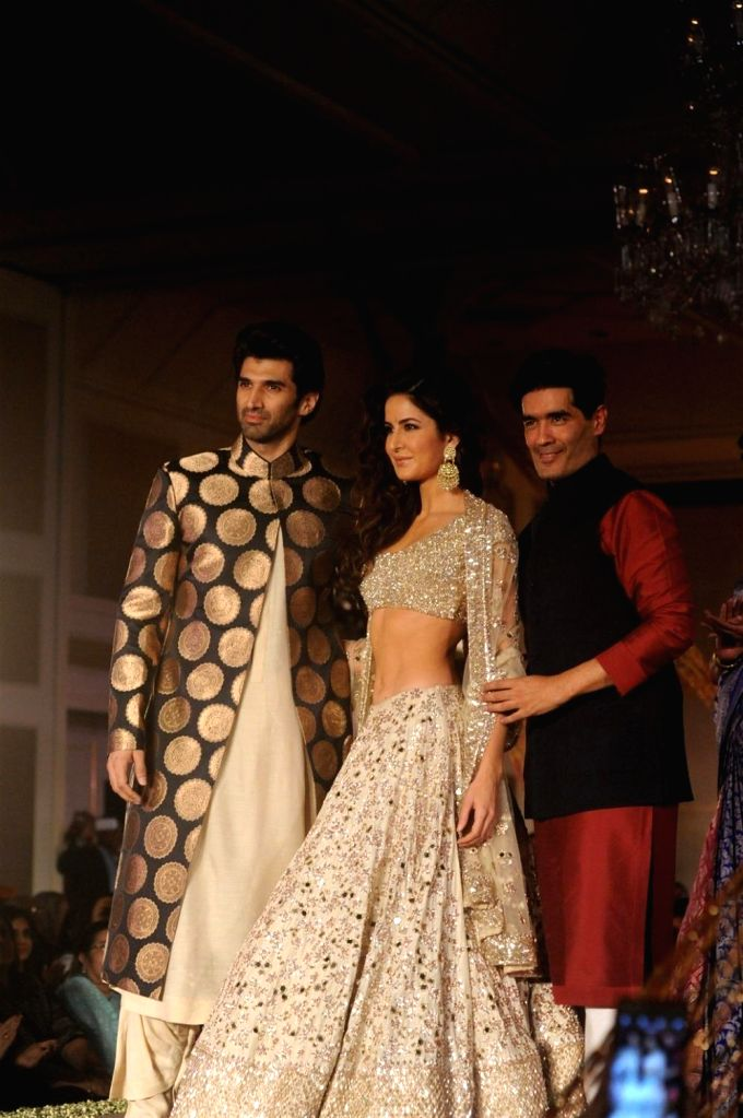 Fashion designer Manish Malhotra with Bollywood actor Katrina Kaif and Aditya Roy Kapur during his fashion show in Mumbai, on January 14, 2016. Manish named the collection as The Regal ... - Katrina Kaif and Roy Kapur