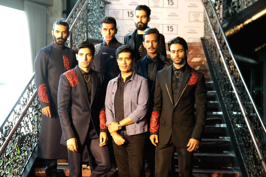 Fashion designer Manish Malhotra with models during the special preview of his upcoming Lakme Fashion Week winter festive show collection in association with Philips India, in Mumbai, on Aug ... - Manish Malhotra