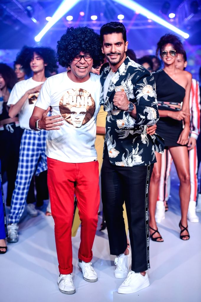 Fashion designer Narendra Kumar with actor Angad Bedi during his show on the second day of Bombay Times Fashion Week 2018, in Mumbai on March 31, 2018. - Angad Bedi and Narendra Kumar