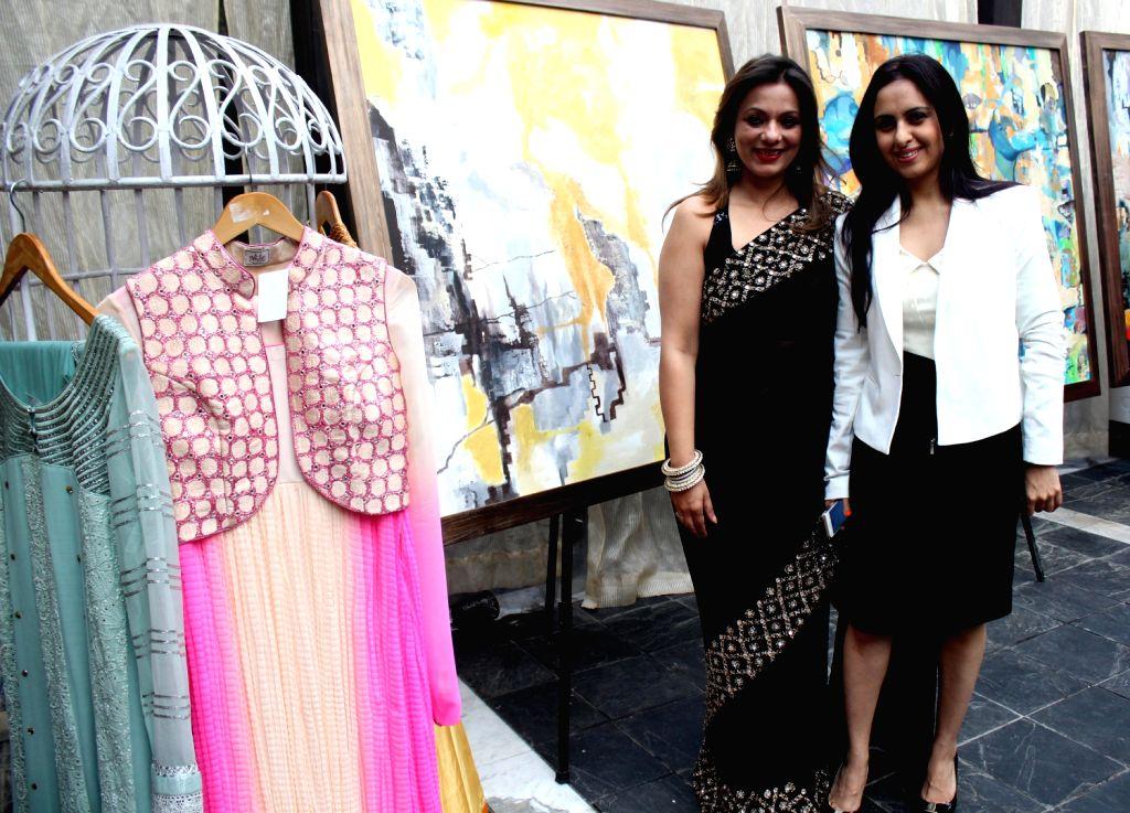 Fashion designer Poonam Bajaj with artist Sunayana Malhotra during `Elements of Fashion and Art` in New Delhi on Dec.19 2013. - Sunayana Malhotra