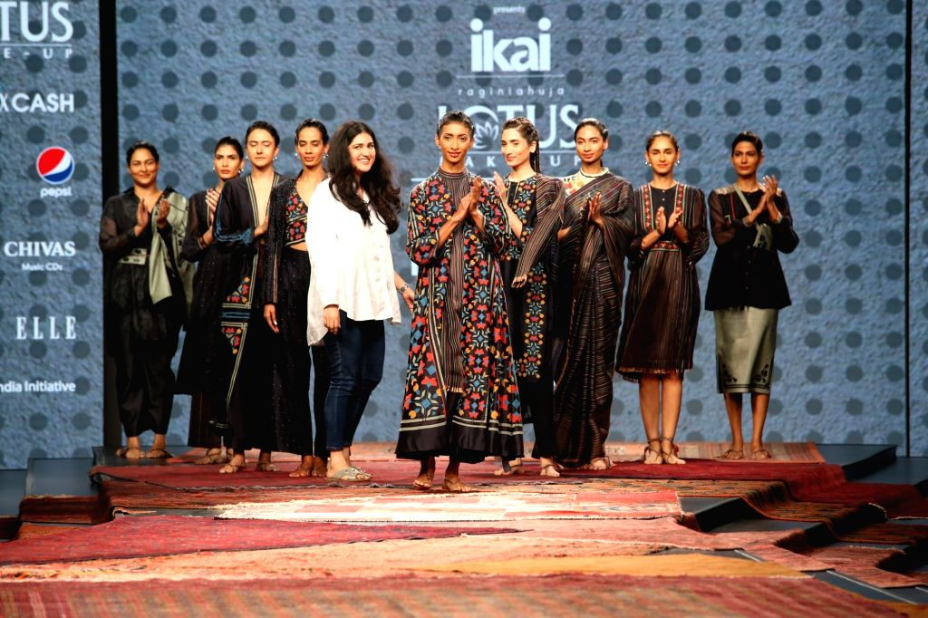 Fashion designer Ragini Ahuja with models showcasing the collection from her fashion label Ikai on the first day of Lotus India Fashion Week, in New Delhi on Oct 9, 2019.