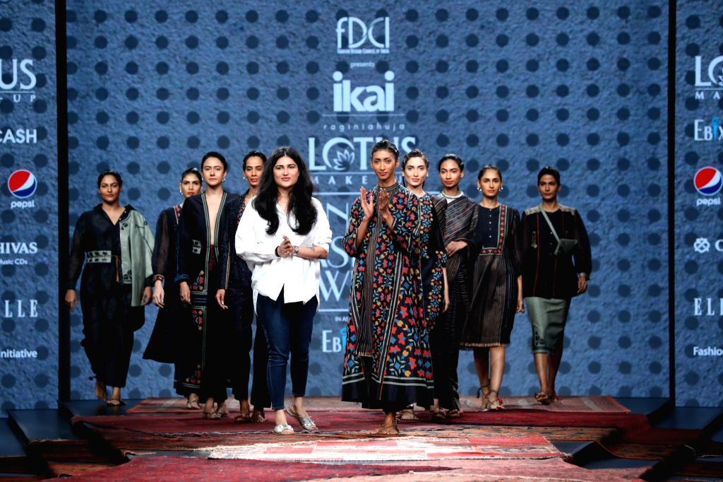 Fashion designer Ragini Ahuja with models showcasing the collection from her fashion label Ikai on the first day of Lotus Make-up India Fashion Week, in New Delhi on Oct 9, 2019.