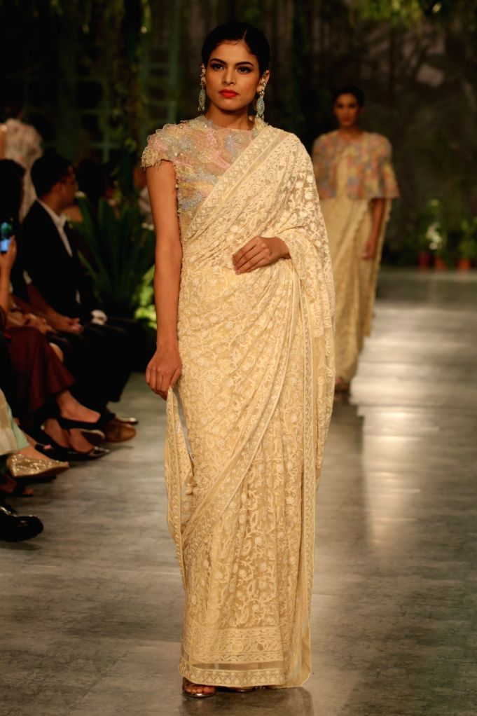 Fashion Designer Rahul Mishra presents a collection of Mughal architecture designs at India Couture Week 2018, in New Delhi, on July 29, 2018. - Designer Rahul Mishra