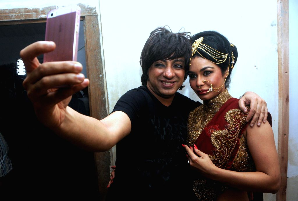 Fashion designer Rohit Verma and actor Kavitta Verma during the preview his newest collection `Vrindavan` presented this Janmashtami, in Mumbai on Aug 14, 2014. - Kavitta Verma