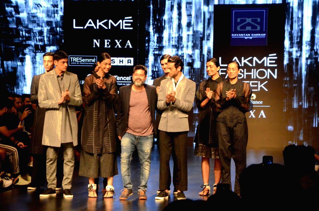 Fashion designer Sayantan Sarkar with models showcasing his creations on Day 3 of the Lakme Fashion Week Summer/Resort 2019 in Mumbai, on Feb 1, 2019.