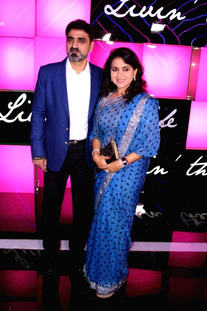 Fashion designer Shaina NC along with her husband Manish Munot during the launch of Ananya Birla`s debut single Livin the Life, in Mumbai, on Nov 12, 2016.