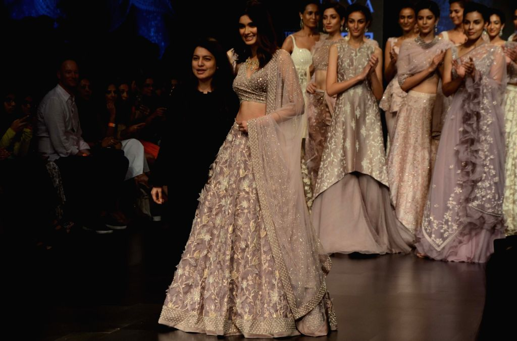 Fashion designer Swapna Anumolu with actress Diana Penty showcasing the creation of her label Mishru during the Lakme Fashion Week (LFW) Summer/Resort 2019 in Mumbai on Feb 3, 2019. - Diana Penty