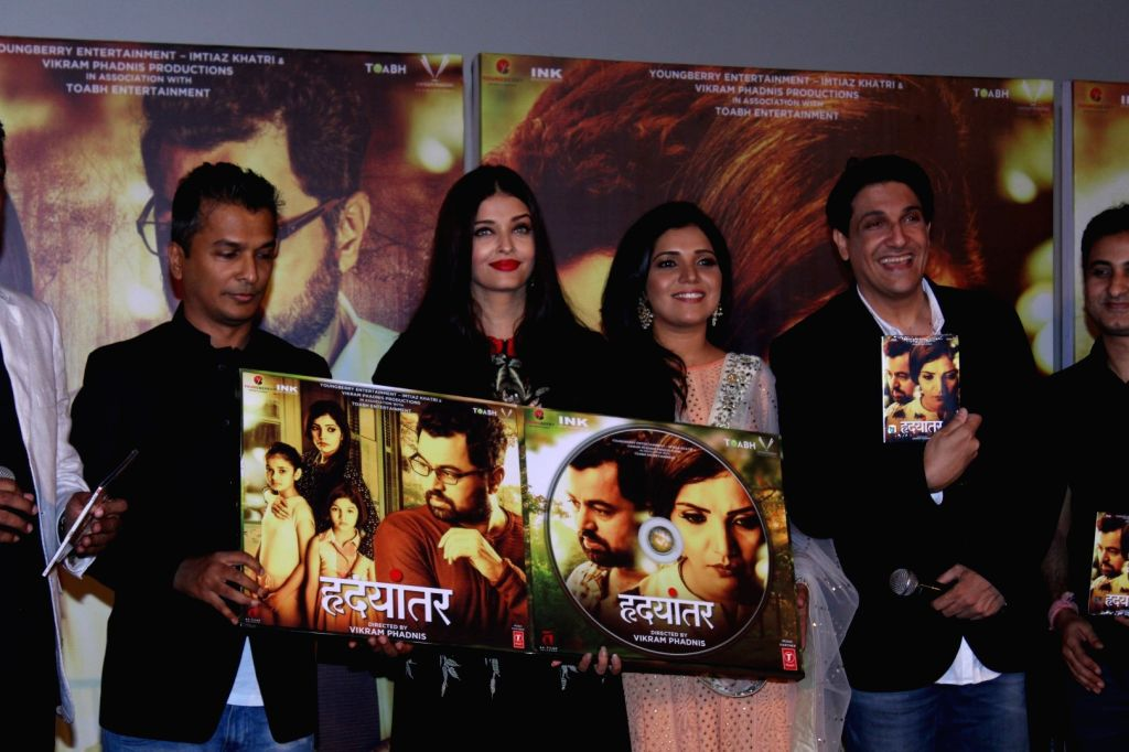 Fashion designer Vikram Phadnis, Bollywood actress Aishwarya Rai, Marathi film actor Mukta Barve and choreographer Shiamak Davar during the music launch of marathi film Hrudayantar in Mumbai, ... - Aishwarya Rai