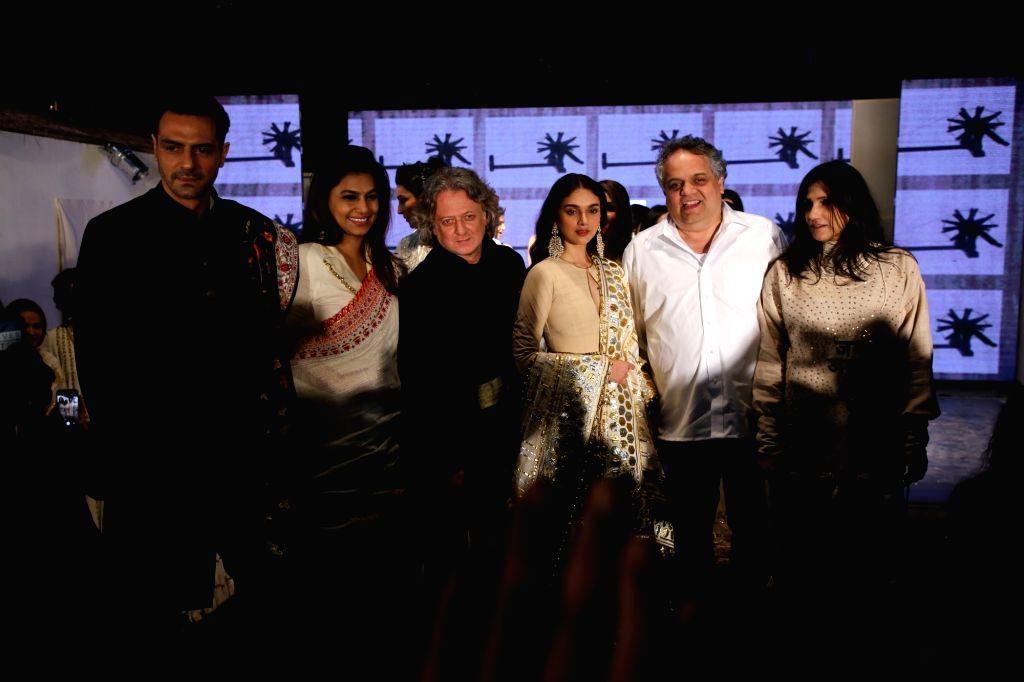"Fashion designers Abu Jani and Sandeep Khosla with actress Aditi Rao Hydari at the ""Khadi Goes Global"" programme, in New Delhi, on Feb 21, 2019. - Aditi Rao Hydari"