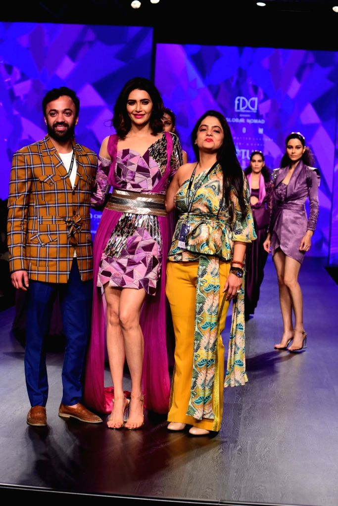Fashion designers Gauri and Kunal with the showstopper Karishma Tanna on the second day of Lotus India Fashion Week in New Delhi, on March 14, 2019.