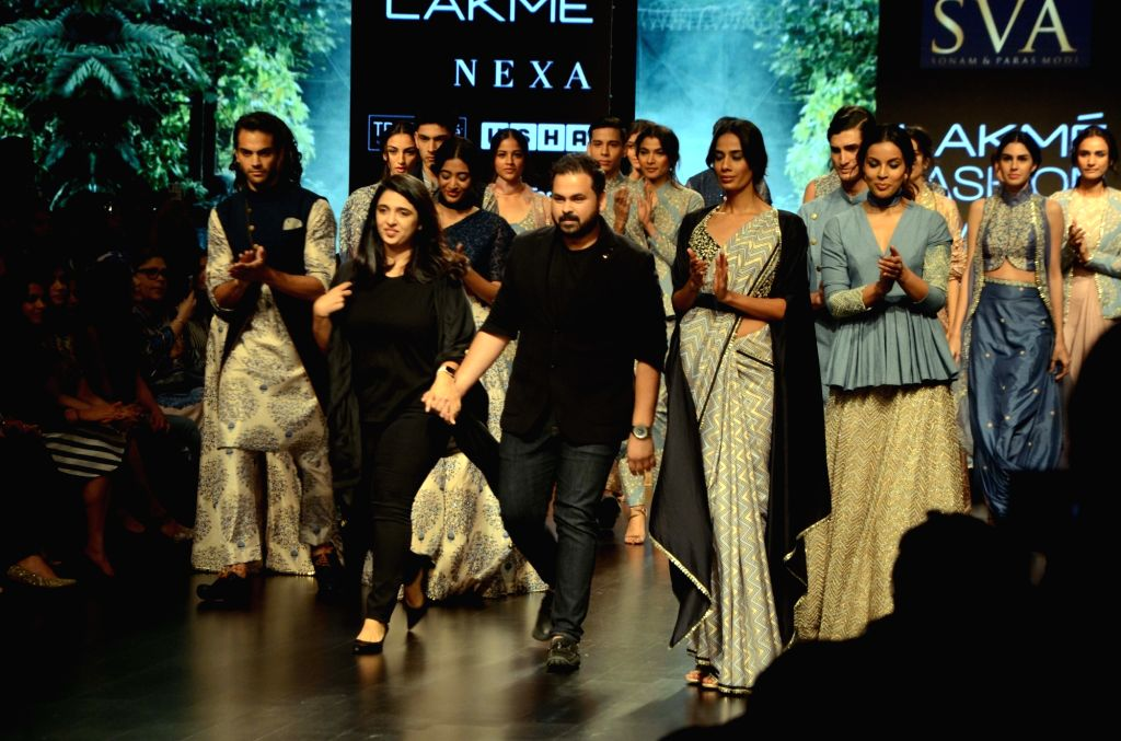 Fashion designers Sonam and Paras Modi with models in their creation on Day 3 of the Lakme Fashion Week Summer/Resort 2019 in Mumbai, on Feb 1, 2019. - Modi