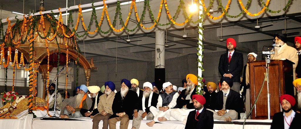 Fatehgarh Sahib: Punjab Chief Minister Parkash Singh Badal addresses during a programme organised to pay homage to Sant Baba Ajit Singh ji Hansali Wale in Fatehgarh Sahib district, Punjab on Jan 10, . - Parkash Singh Badal