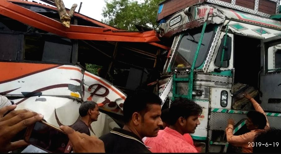 Fatehpur: The site where a speeding bus collided with a truck at Bilari-Kaunh Modh under the Chaandpur police station area of Fatehpur district of Uttar Pradesh, on June 19, 2019. Seven persons were killed and 25 others injured in the accident. (Phot