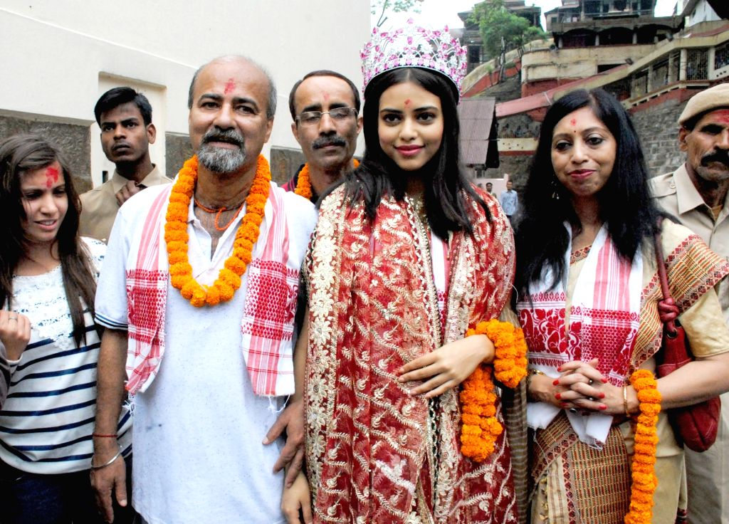 FBB Femina Miss India World winner Priyadarshini Chatterjee with her family visit Kamakhya Temple in Guwahati on April 18, 2016. - Priyadarshini Chatterjee