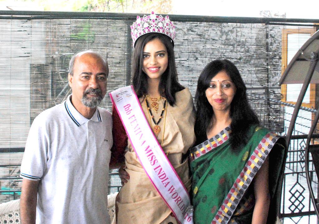 FBB Femina Miss India World winner Priyadarshini Chatterjee with her family addresses a press conference in Guwahati on April 18, 2016. - Priyadarshini Chatterjee
