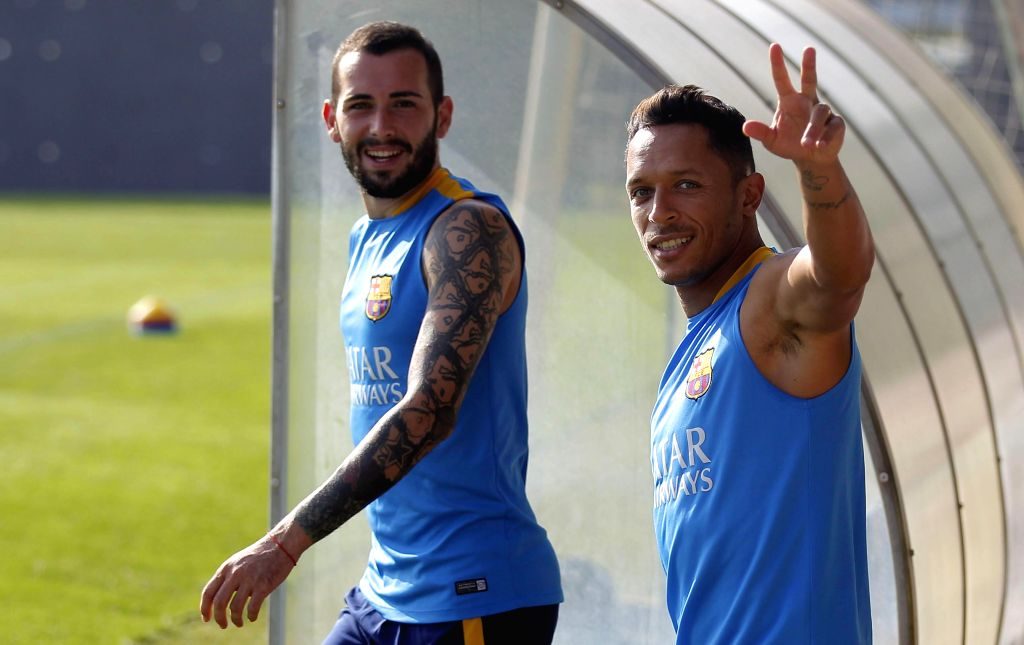 FC Barcelona's players, Spanish Aleix Vidal (L) and Brazilian Adriano, during a team's training sesion at Joan Gamper Sports City in Barcelona, northeastern Spain, 04 August 2015. FC ...