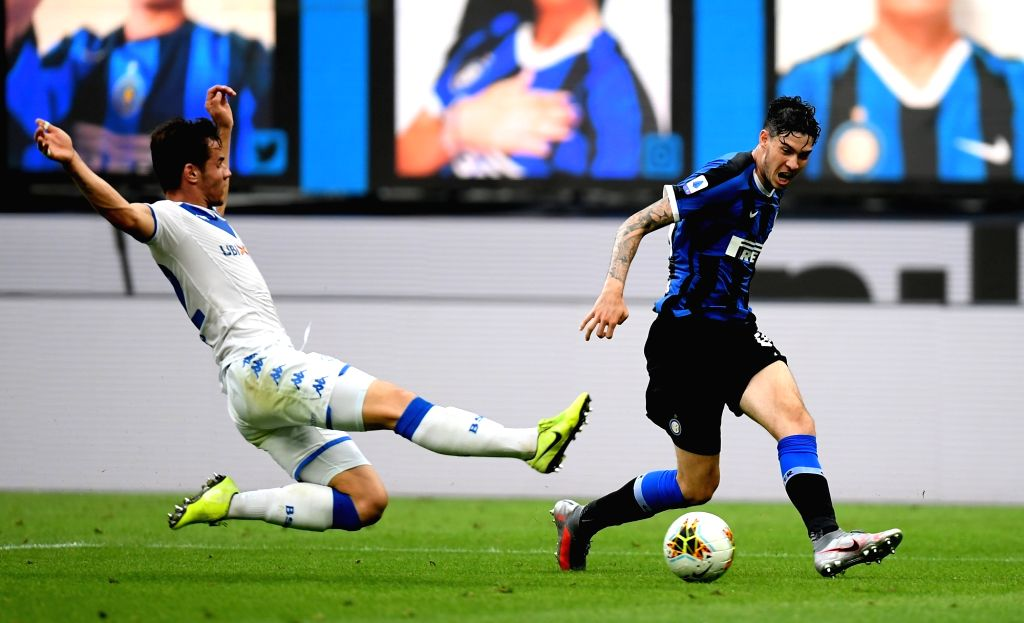 FC Inter's Alessandro Bastoni (R) competes during a Serie A football match between FC Inter and Brescia in Milan, Italy, July 1, 2020.