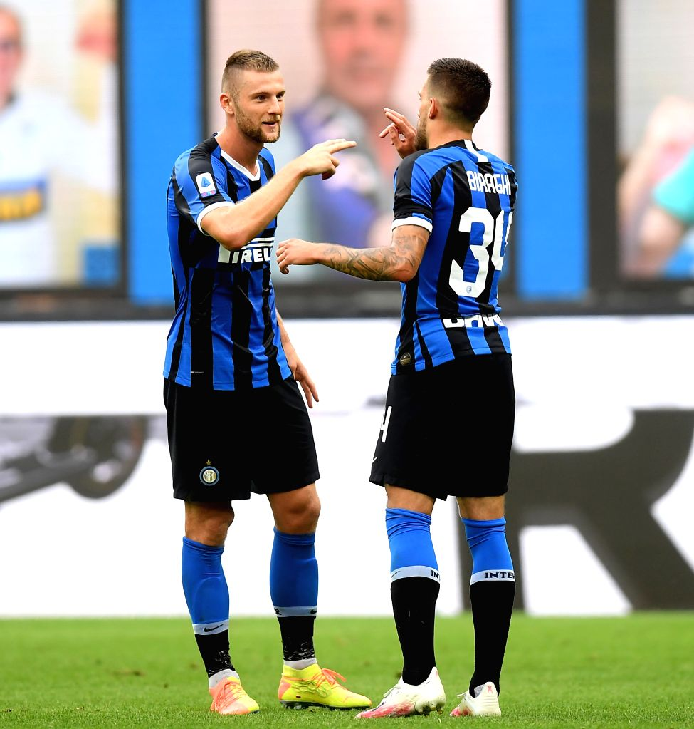 FC Inter's Cristiano Biraghi (R) celebrates scoring with teammate during a Serie A football match between FC Inter and Sassuolo in Milan, Italy, June 24, 2020.