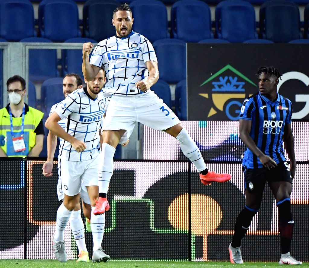 FC Inter's Danilo D'Ambrosio (top) celebrates his goal during a Serie A football match between Atalanta and FC Inter in Bergamo, Italy, Aug. 1, 2020.