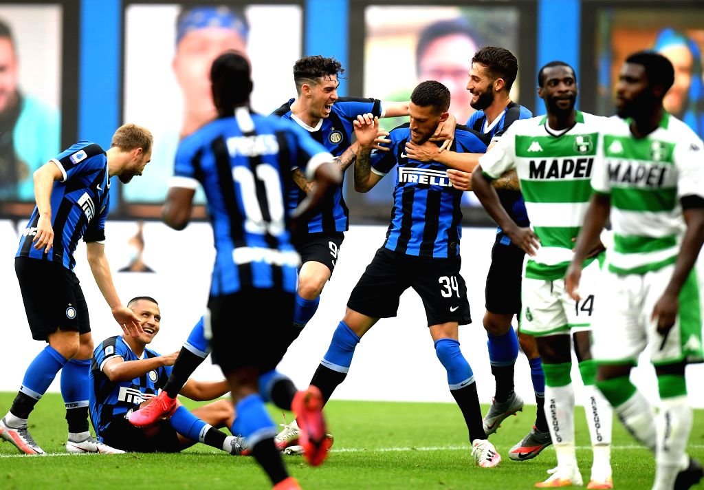 FC Inter's players celebrate their goal during a Serie A football match between FC Inter and Sassuolo in Milan, Italy, June 24, 2020.