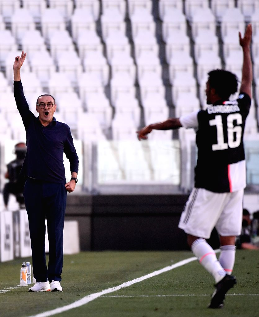 FC Juventus' head coach Maurizio Sarri (L) reacts during a Serie A football match between FC Juventus and Torino in Turin, Italy, July 4, 2020.
