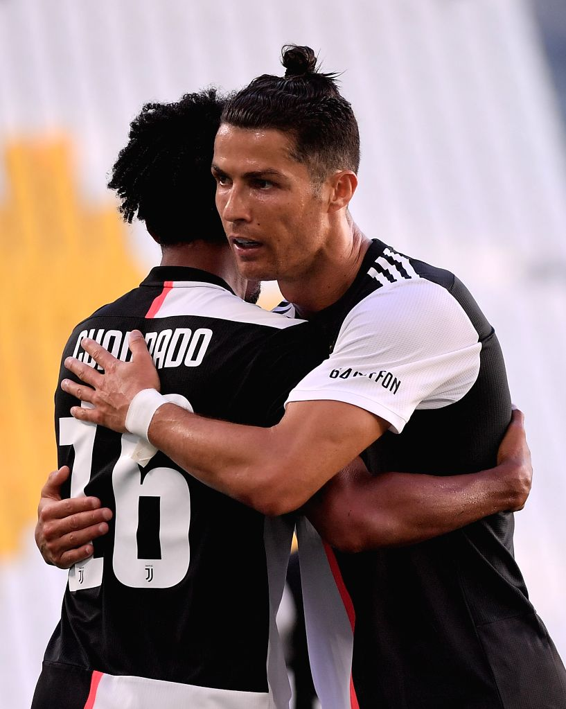 FC Juventus' Juan Cuadrado (L) celebrates his goal with Cristiano Ronaldo during a Serie A football match between FC Juventus and Torino in Turin, Italy, July 4, 2020.