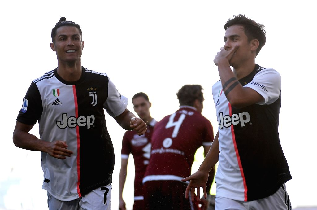 FC Juventus' Paulo Dybala (1st R) celebrates his goal during a Serie A football match between FC Juventus and Torino in Turin, Italy, July 4, 2020.