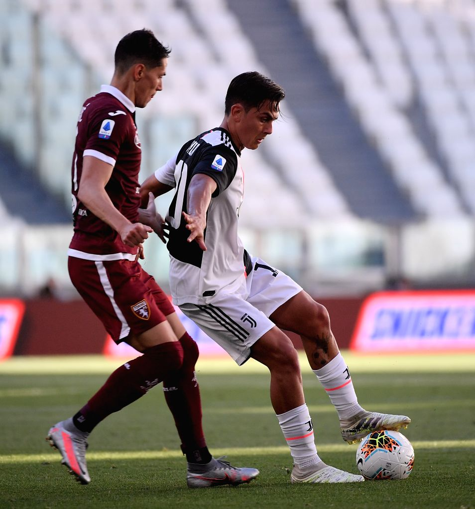 FC Juventus' Paulo Dybala (R) vies with Torino's Sasa Lukic during a Serie A football match between FC Juventus and Torino in Turin, Italy, July 4, 2020.