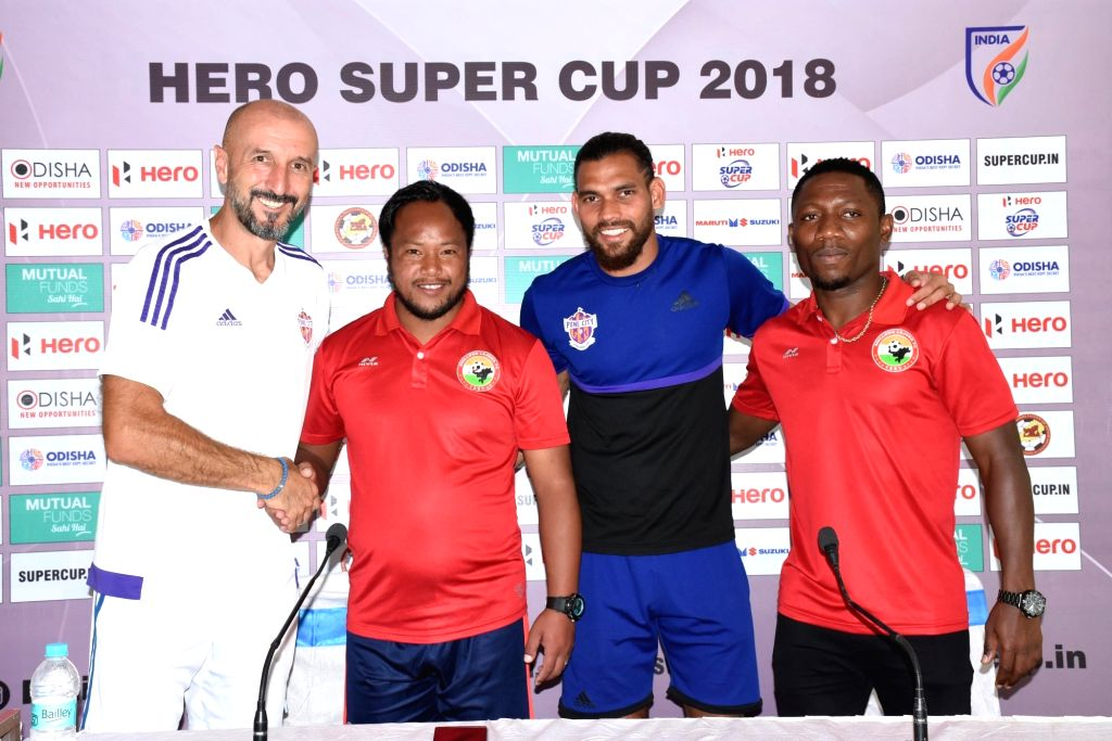 FC Pune City coach Ranko Popovic with Shillong Lajong FC assistant coach Alison during a press conference ahead of a Super Cup match between the two teams to be held on April 4 at ...
